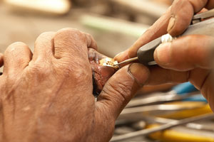 goldsmith making a gold ring