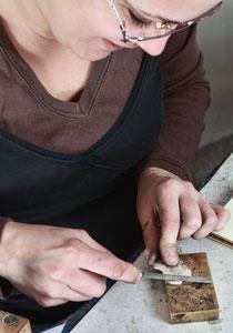 jeweler using a file