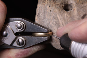 drilling a hole in a ring