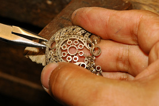 craftsman making gold jewelry